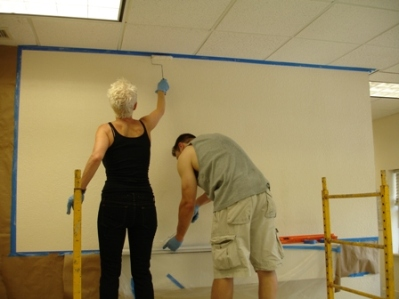Rebecca and Henri working together on the wall sizing