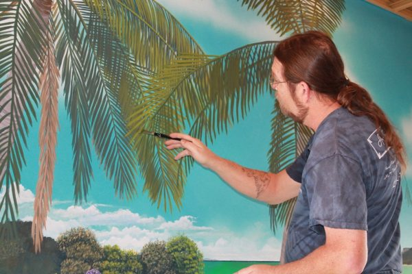 """Painting palm trees for Marco Island restaurant """"The Islander"""" by artist Arthur Morehead"""